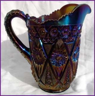 up for auction today is an antique carnival glass water pitcher made